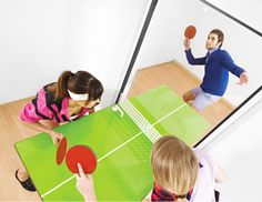 Turn any room into an exciting game room after you install the ping pong door. The genius design of the ping pong table allows you to play Forrest Gump style when you're by yourself – or flip it forward for a challenging full table game with your friends. Indoor Climbing Wall, Bookcase Door, Decoration Originale, Sink Design, Secret Rooms, Biro, Space Saving Furniture, House Furniture, Deco Design