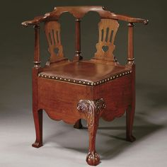"""Corner Commode Chair - attr. Robert Walker, 1755-1760, Mahogany. """"Through the study of the provenance of a single chair, we have linked together both previously known and new information... With the mention of a sole arm chair in Landon Carter's probate inventory, and direct descent through his daughter, we learn that Charles Carter's third """"arm'd chair"""" is very likely MESDA's corner chair attributed to Robert Walker."""" On view in the Cherry Grove Chamber"""