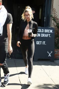 Hailey Baldwin wearing Alo Yoga Shell Mesh-Sleeve Cropped Sport Bomber Jacket, Puma x Stampd Blaze of Glory Strap, Alo Yoga Undertone Legging