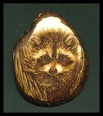 'Racoon' - the name says it all;) Pyrography on tagua slice. Sold