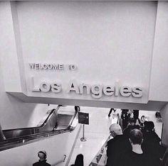 LAX Terminal 1 escalator down to baggage claim