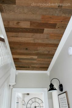 WOOD CEILING! Finished off with crown molding - love this look!