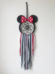This mini Minnie Mouse dream catcher is on a 4 hoop (so around 5 or 6 inches wide with the ears). Available in classic red polka dot, or a pink floral bow