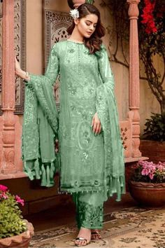 Pull together a chic look when you wear this mint green georgette trouser suit which exudes feminine charm. This round neck and full sleeve party wear attire beautified with sequins and thread work. Matched with santoon straight pants in mint green color with mint green nazneen dupatta. Straight pants has thread and sequins work. #trousersuit #salwarkameez #malaysia #Indianwear #Indiandresses #andaazfashion Pakistani Fashion Party Wear, Pakistani Outfits, Eid Dresses, Indian Dresses, Pakistani Suits Online, Eid Outfits, Pantalon Cigarette, Cotton Salwar Kameez, Georgette Fabric