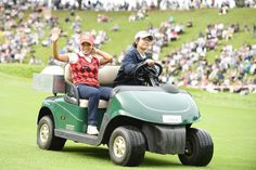 Bo-Mee Lee of South Korea smiles in golf cart as she is driven to the 18th tee for a playoff during the final round of the Stanley Ladies Golf Tournament at the Tomei Country Club on October 9, 2016 in Susono, Japan.
