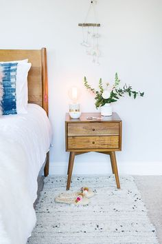 West Elm nightstand, a runner, and a wooden bed frame make this such a cozy bedroom | The Glitter Guide