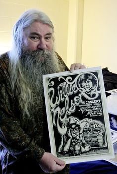 Micael Priest, one of the stable of fine artists creating posters for Austin's legendary Armadillo World Headquarters (1970-80), holding his poster for a 'Dillo concert by Willie Nelson.