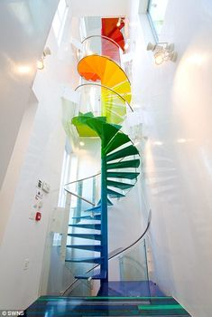 The unusual house, which features a rainbow coloured spiral staircase was redesigned in 2009