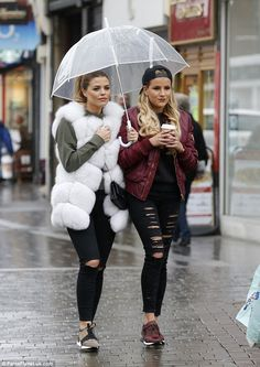 Gotta see it to believe it: Co-stars Georgia Kousoulou and Chloe Lewis were on hand to witness the moment as they stood under an umbrella together