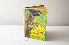 "We absolutely adore vintage GDR books!  Beautiful typography, nice stories, nice colors, good paper choice and, above all, stunning illustrations!    This one is a perfect example of this.    Title is ""Spatz spätzchen"", meaning ""Sparrow, little sparrow"".  Printed in the USSR in 1977. East Germany DDR. €23.00"