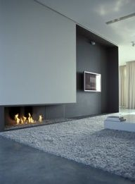 lovely detail of integrating media within a fireplace wall. Image Credit: Loft B by Belgian Iso architects Gray Interior, Modern Interior Design, Interior Architecture, Stone Interior, Fireplace Wall, Fireplace Design, Wall Fireplaces, Fireplace Ideas, Fireplace Modern