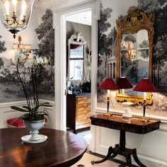 Statement-making wallpaper paired with a beautiful French mirror is a risk, but it pays off here. Love this entryway. #hollywoodregency #kathykuohome