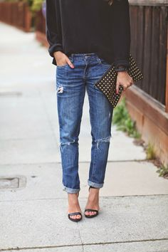 black shirt, ripped jeans and heels