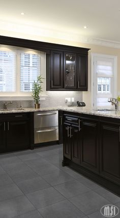 MOON WHITE granite with dark cabinets and grey floor