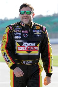 Tony Stewart, driver of the #14 Rush Truck Centers/Mobil 1 Chevrolet, walks on pit road during qualifying for the NASCAR Sprint Cup Series Hollywood Casino 400 at Kansas Speedway on October 3, 2014 in Kansas City, Kansas.