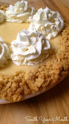 Atlantic Beach Pie - a creamy, tart lemon filling in a crunchy, thick saltine cracker crust topped with whipped cream!