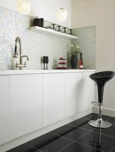 Rainbow Pearl Mosaic form Topps Tiles. I know it shows a kitchen but what about for a bathroom...