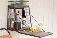 Wall Mounted Cabinet With Fold Down Shelf - From Antiquefarmhouse.com - http://www.antiquefarmhouse.com/current-sale-events/farmhouse-accents-decor/wall-mounted-liquor-cabinet-with-fold-down-shelf.html
