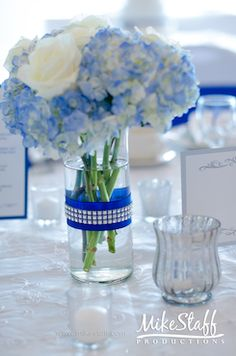 blue hydrangea white rose wedding centerpiece
