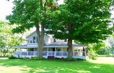 Beautiful historic farmhouse on 10 acres with pond and classic wrap-around porch - Historic Homes by the Michigan Lifestyle Property Network