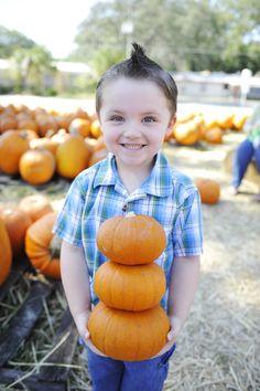 Stacking pumpkins gives pumpkin patch photos a new look