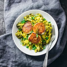 This scallop risotto is paired with broccoli florets and corn, and simmered with saffron threads for a flavorful dish. Scallops are a great choice here.