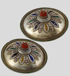 Mongolia | Silver, enamel. coral | 20th century | Women in this region complement their headdresses with temple pendants like these which are decorated with enameling and pieces of coral.