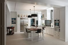 Devonshire Raise Panel maple White Icing Classic Paint and cherry Brandywine Ebony Glaze wood top. Order Medallion Cabinetry direct from factory; 650-704-2221