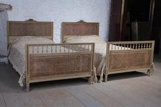 pretty pair of french meter wide caned gilded beds