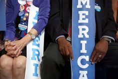 """America"" signs were handed out before former President Bill Clinton spoke on Day 2."