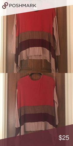 Long sleeve stripped shirt Long sleeve stripped shirt. Tan, maroon, brown, and burnt orange. Hangs longer on the sides Tops Tees - Long Sleeve