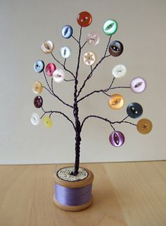 This colorful button tree utilizes old buttons and thread bobbins for a one-of-a-kind work of art my seniors would be proud to display as well as give away.