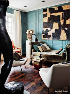 Vintage style living room with teal walls