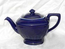 Hall China Company's Hollywood shape teapot in cobalt blue, white trim on rim, flaring foor, ceramic, USA