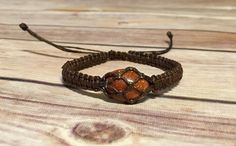 Handmade healing/energy bracelet is made with a waxed brow hemp cord, with one gold Sandstone oval (oval - 18x13mm) netted in the middle.  One size