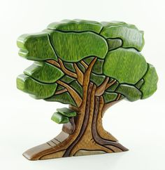 Old Oak Tree (TR15) Amazing unique wood art by artists John and Martha Barrow. Each wooden sculpture is made of Amazonian Ishpingo wood (Scientific name: Amburana Ceará) that is crafted by hand and is colored using natural dyes. Learn more at: www.zollera.com