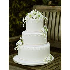 White wedding cake ❤ liked on Polyvore featuring food, cake and wedding cakes