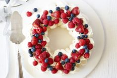 This traditional pavlova is filled with cream and seasonal berries.