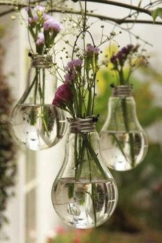 Lightbulb Flowers. This would be cute for like outdoorsy wedding decoration.