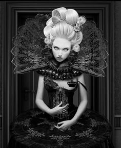 Love This From the Hair to the Neck Fan to the Corset and the Contrast of the Black and White