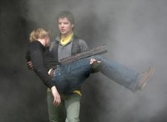 Connor carrying Nick Cutter out of the smouldering reckage of th Ark after Helen shot him. .....tear.....