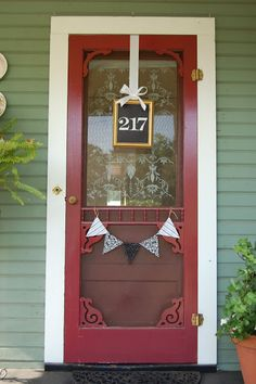 Add some flair to your front door with a picture frame hung from a satin ribbon.