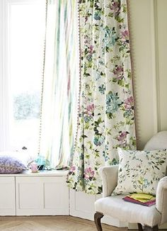 Prestigious Textiles -  Italian Garden Fabric Collection - Striped voile and floral curtains, both edged with pink beads, with a beige armchair and two floral cushions