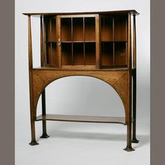 British, circa 1890  an Arts & Crafts oak display cabinet