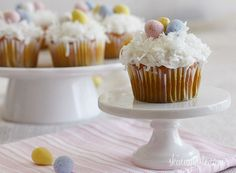 Coconut Cupcakes w/ Chocolate Eggs - These use cake mix made with applesauce and coconut milk instead of oil.