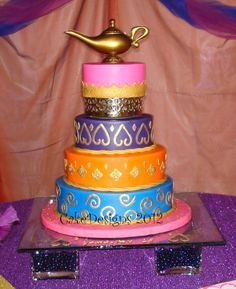"""Arabian Theme Quinceanero - 6, 8, 10 &12 x 3"""" for an arabian nights quinceanero iced in buttercream with fondant decorations.  Gold painted with airbrush and paintbrush.  Tip: better to cut your fondant shape(mixed with some tylose), airbrush it gold, let it dry a little a few minutes and then apply. The shinier gold was done by applying the decorations and then painting with brush but that took forever. Design loosely based on EH4642's Bollywood cake. Hers is a lot prettier, check it out."""