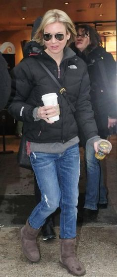 Who made Renee Zellweger's jeans, brown boots, black jacket and sunglasses that she wore to Starbucks in Berlin, Germany? Jeans – 7 For All Mankind Vintage California Josefina  Sunglasses – Ray Ban  Shoes – Uggs  Jacket – Northface