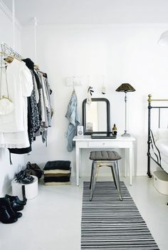Kinda like this open closet.  11 Closet Ideas for the Minimalist Girl via @WhoWhatWear