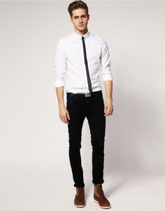 Casual fancy: thin black tie, solid white shirt, black pants, boots.