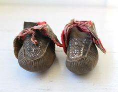 antique native american moccasins.